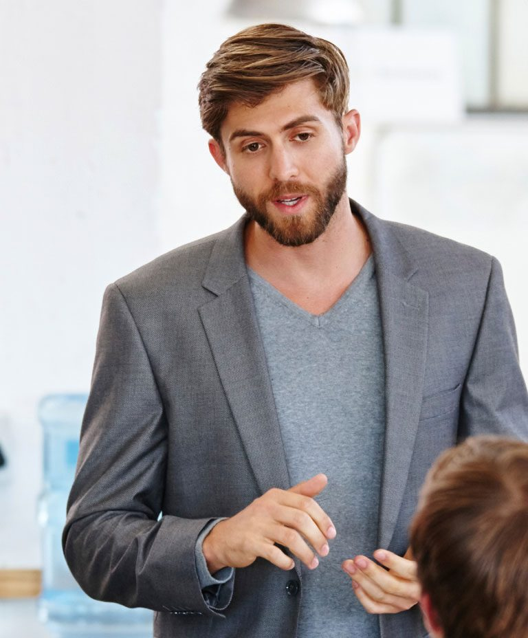 Man presenting in front of small group